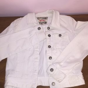 white jean jacket with small white flower detail